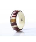 Antonella Piacenti, bracciale rigido in resina naturale epossidica, seta e argento. Colore Rosso BATIK Java